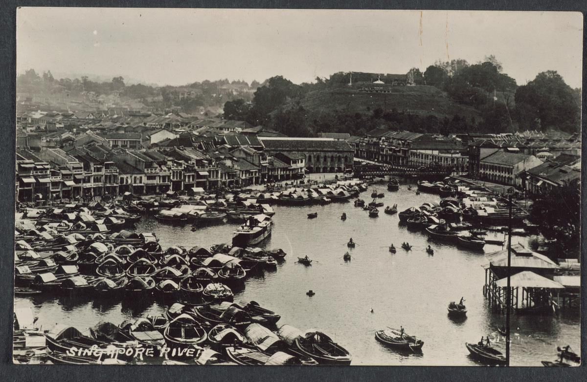 Scene of the crowded Singapore River and Fort Canning