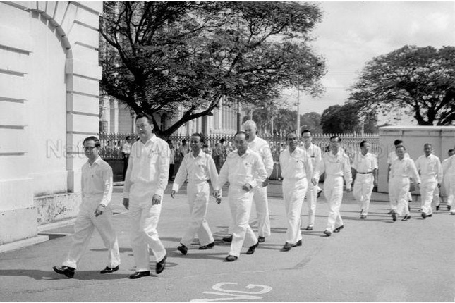Toh Chin Chye walking to the start of the third Legislative Assembly session