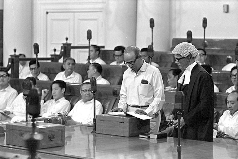 "Minister for Foreign Affairs and for Labour and Member of Parliament for Kampong Glam, S. Rajaratnam taking the oath of allegiance at the first meeting of Singapore Parliament in Parliament House, Empress Place, 1968. Mr  Rajaratnam said in a Parliamentary speech in 1967: ""In a democracy there can be no distinction between majority rights and minority rights. There can only be equality of rights, the same rights for all, without regard to race, colour, language or creed."""