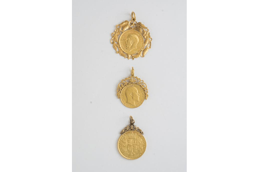 A set of British coin pendants collected by Samuel Dhoraisingam and Kamala Devi Dhoraisingam in their efforts to document Chetti Melaka heritage