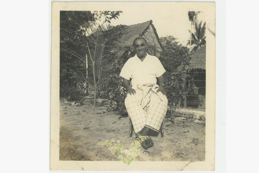 A photograph of MT Pillay in a checkered sarong