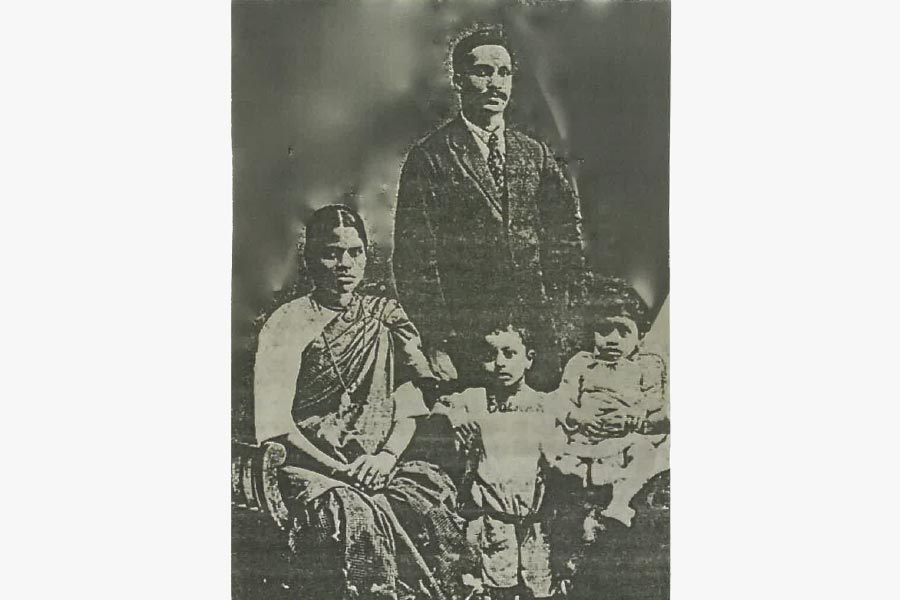 Studio portrait of Meenachi Sundram with wife Kamala aka Jessie sons Monie and Chellie Sundram