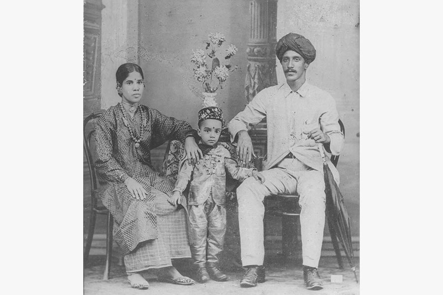Studio portrait of Shanmugam Pillai with wife Kamalambal and eldest son