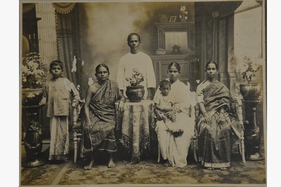 Family portrait of cattle trader Kuppusamy with his mother (sitting first from left), wife Angammal (in the centre) with her daughter, Lakshmi on her lap) and sister Ponnammal (on the right)