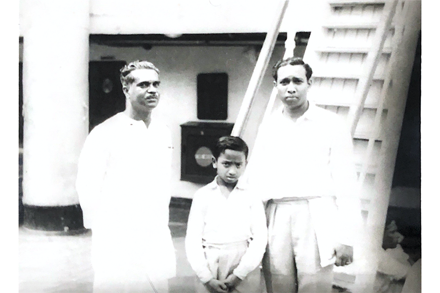 Mr Adhynamilagi, Mr Adhynarayanan and a family friend on board the SS Rajula