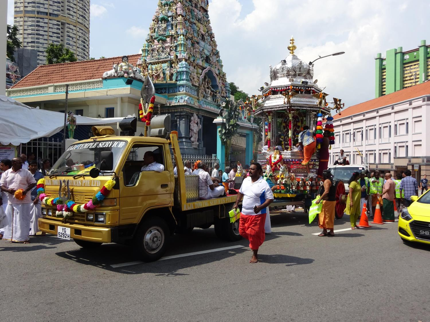 In Singapore, the silver chariot – a huge processional cart carrying an image or idol of the festival's presiding deity – is towed along a public route for worshippers.