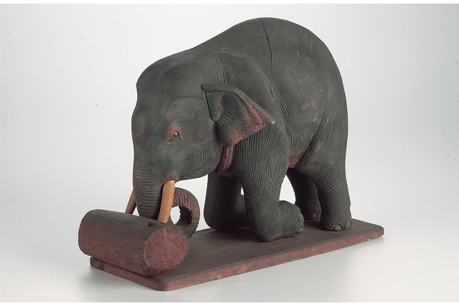 model-of-elephant-moving-logs