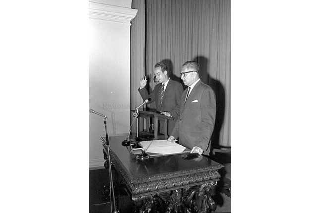 E W Barker at the Swearing in session for his post as Minister of Law