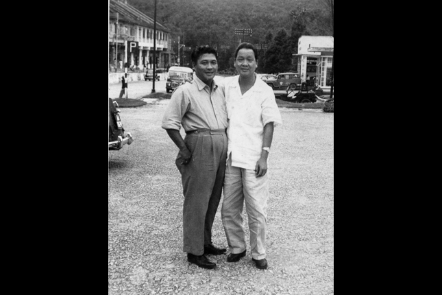 The owner of Green Bus Company, Mr. Ong Cheng Siang (standing on the right), grandfather to Mr. Patrick Ong, with his friend. Photograph courtesy of Patrick Ong