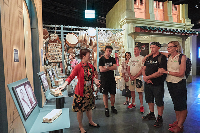 Clara feels proud to share Singapore's history with visitors.