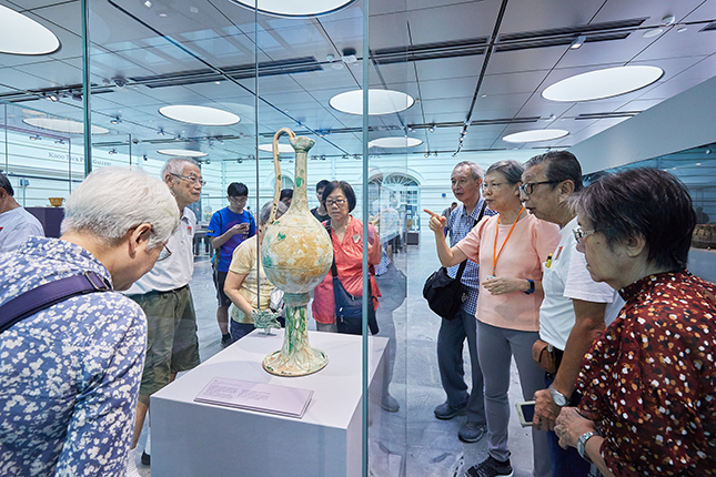 Interactions with the museum's visitors energises Wen Sze, who is always ready to answer questions about the museum's collections.