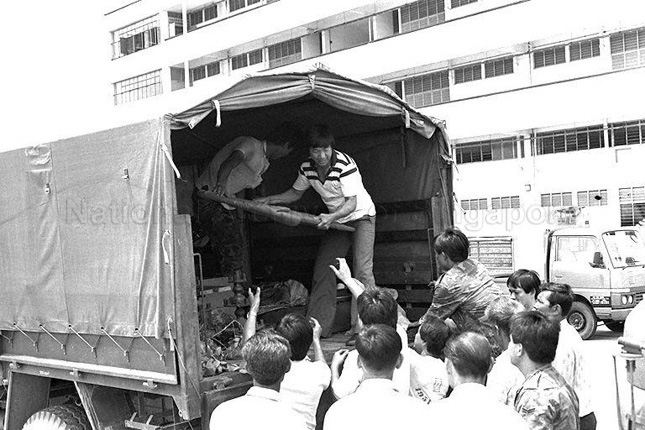 Army personnel assisting residents of Pulau Tekong in relocating to mainland Singapore