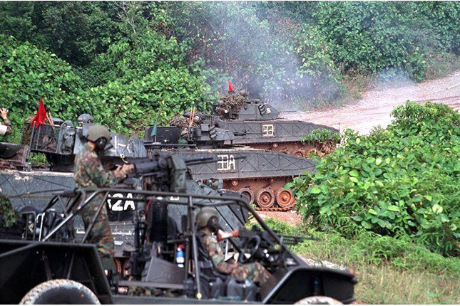Reservist NS Men conducting live firing exercise