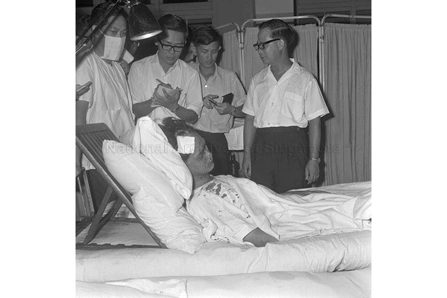 Deputy Prime Minister Toh Chin Chye visits victims of the MacDonald House bombing