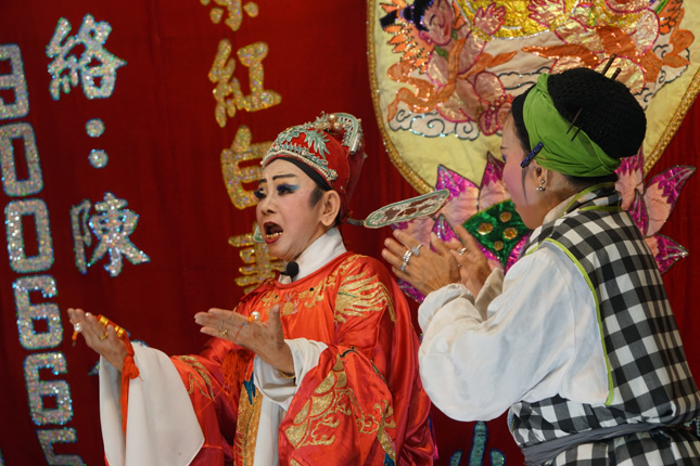 Opera actresses in the midst of a performance at Nine Emperor God Festival in Singapore