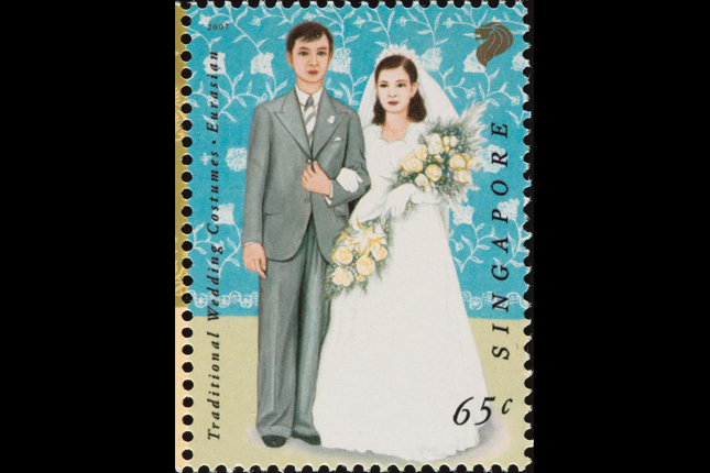 Stamp featuring traditional Eurasian wedding costumes